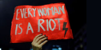 Every Woman is a riot poster